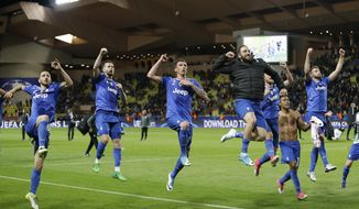 Juventus players celebrate after winning the Champions League semifinal first leg soccer match between Monaco and Juventus at the Louis II stadium in Monaco, Wednesday, May 3, 2017. (AP Photo/Claude Paris)
