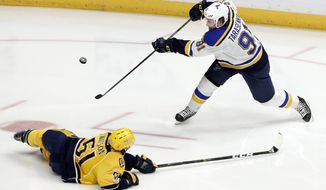 Nashville Predators left wing Austin Watson (51) blocks a shot by St. Louis Blues right wing Vladimir Tarasenko (91), of Russia, during the third period in Game 4 of a second-round NHL hockey playoff series Tuesday, May 2, 2017, in Nashville, Tenn. The Predators won 2-1 to take a 3-1 lead in the series. (AP Photo/Mark Humphrey)