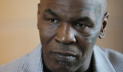 """Mike Tyson gives an interview to The Associated Press, in Dubai, United Arab Emirates, Thursday, May 4, 2017. Tyson is in Dubai to announce the start of his worldwide boxing gym franchise. Tyson said Thursday that a city like Dubai can show people the best of the Middle East, its people and Islam. Tyson praised the sheikhdom as """"a party place, a place you have a good time at. This is like New York, man!"""" He said that contradicts some negative perceptions of the Mideast. (AP Photo/Kamran Jebreili)"""
