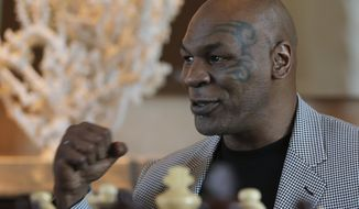 """Mike Tyson makes a fist during an interview with The Associated Press, in Dubai, United Arab Emirates, Thursday, May 4, 2017. Tyson is in Dubai to announce the start of his worldwide boxing gym franchise. Tyson said Thursday that a city like Dubai can show people the best of the Middle East, its people and Islam. Tyson praised the sheikhdom as """"a party place, a place you have a good time at. This is like New York, man!"""" He said that contradicts some negative perceptions of the Mideast. (AP Photo/Kamran Jebreili)"""