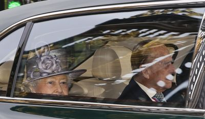 Britain's Queen Elizabeth II leaves Buckingham Palace by car with Prince Philip for an engagement in London, Thursday, May 4, 2017. Prince Philip, the consort known for his constant support of his wife Queen Elizabeth II as well as for his occasional gaffes, will retire from royal duties this fall, Buckingham Palace said Thursday. (AP Photo/Alastair Grant)