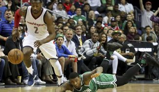 Boston Celtics guard Marcus Smart (36) dives after a ball stollen by Washington Wizards guard John Wall (2) during the first half in Game 3 of a second-round NBA playoff series basketball game, Thursday, May 4, 2017, in Washington. (AP Photo/Andrew Harnik)