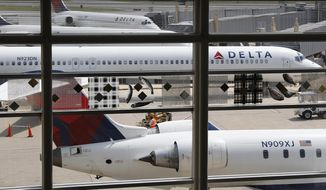 FILE - In this Monday, Aug. 8, 2016, file photo, Delta Air Lines planes are parked at Ronald Reagan Washington National Airport, in Washington. A California family says they were forced off a Delta plane and threatened with jail after refusing to give up one of their children's seats on a crowded flight. A video of the April 23, 2017, incident was uploaded to Facebook on Wednesday, May 3, 2017, and adds to the list of recent encounters on airlines that went viral, including the dragging of a passenger off a United Express plane. (AP Photo/Carolyn Kaster, File)