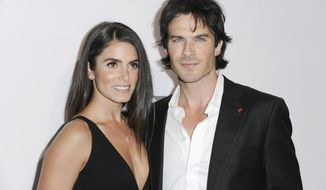 """FILE - In this May 7, 2016 file photo, Nikki Reed, left, and Ian Somerhalder attend """"To the Rescue: Saving Animal Lives"""" Gala and Fundraiser held at Paramount Pictures Studio in Los Angeles. Reed and Somerhalder announced on Thursday, May 4, 2017, that they are expecting their first child. The actors announced Reed's pregnancy in separate Instagram posts that expressed their joy and already strong feelings about their unborn child. (Photo by Richard Shotwell/Invision/AP, File)"""