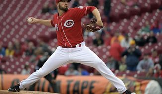 Cincinnati Reds pitcher Tim Adleman pitches in the first inning of a baseball game against the Pittsburgh Pirates, Thursday May 4, 2017, in Cincinnati. (AP Photo/Michael E. Keating)