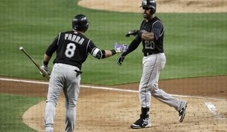 Colorado Rockies' Ian Desmond, right, is greeted by  Gerardo Parra after hitting a home run during the fifth inning of a baseball game against the San Diego Padres on Wednesday, May 3, 2017, in San Diego. (AP Photo/Gregory Bull)