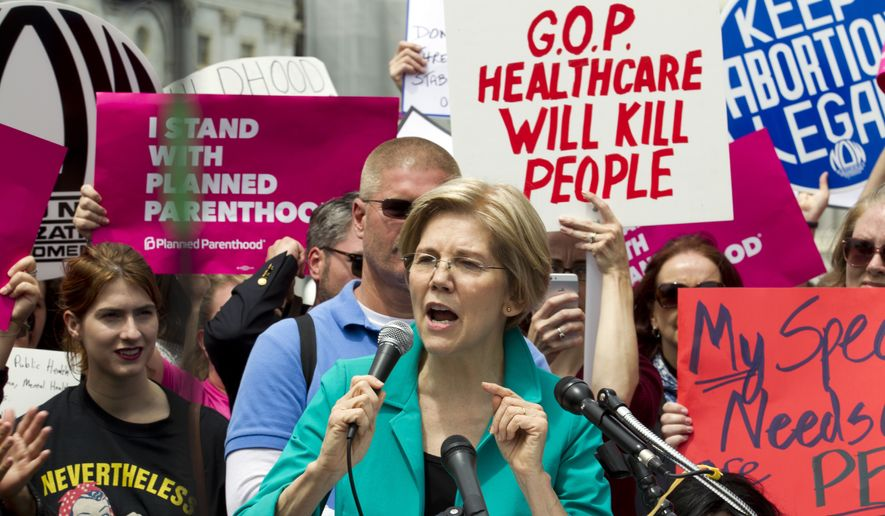 Sen. Elizabeth Warren, Massachusetts Democrat, spoke at a demonstration on Capitol Hill on Thursday after House Republicans pushed their legislative centerpiece scuttling much of former President Barack Obama's health care law. ( Associated Press)