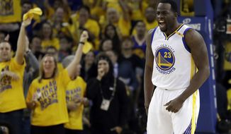 Golden State Warriors' Draymond Green (23) celebrates after scoring against the Utah Jazz during the first half in Game 2 of an NBA basketball second-round playoff series, Thursday, May 4, 2017, in Oakland, Calif. (AP Photo/Marcio Jose Sanchez)