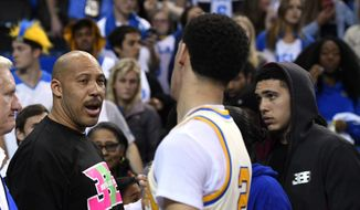FILE - In this March 4, 2017, file photo, UCLA guard Lonzo Ball, right, shakes hands with his father LaVar following an NCAA college basketball game against Washington State in Los Angeles. UCLA won 77-68. LaVar Ball's Big Baller Brand unveiled a signature shoe for Lonzo Ball on May 4, 2017 with a price tag of $495 a pair. (AP Photo/Mark J. Terrill, File) **FILE**