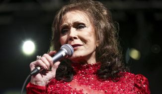 FILE - In this March 17, 2016 file photo, Loretta Lynn performs at the BBC Music Showcase at Stubb's during South By Southwest in Austin, Texas. A posting on country music legend Lynn's website says she has been hospitalized after having a stroke. The posting says Lynn was admitted into a Nashville hospital on Thursday night, May 4, 2017, after suffering the stroke at her home in Hurricane Mills, Tenn. (Photo by Rich Fury/Invision/AP, File)