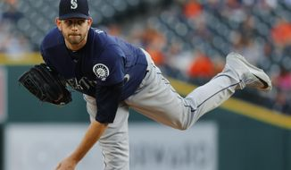 FILE + In this April 26, 2017, file photo, Seattle Mariners pitcher James Paxton throws against the Detroit Tigers in the first inning of a baseball game in Detroit. The Mariners will be without Paxton for at least a couple of starts after he was placed on the 10-day disabled list with a left forearm strain. (AP Photo/Paul Sancya, File)