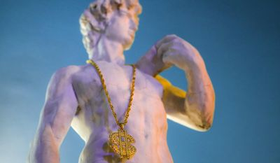 In this Thursday, May 4, 2017, photo a replica of Michelangelo's world-famous statue of David wearing a gaudy gilt necklace with a large US dollar ($) pendant, stands at the entrance to the newly opened Bucharest Kitsch Museum, in Bucharest, Romania. The Kitsch Museum opens for visitors on Friday, May 5, 2017 .(AP Photo/Vadim Ghirda)
