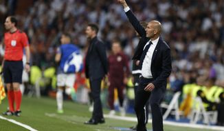 Real Madrid's head coach Zinedine Zidane gives instructions to his players during the Champions League semifinal first leg soccer match between Real Madrid and Atletico Madrid at the Santiago Bernabeu stadium in Madrid, Spain, Tuesday, May 2, 2017. (AP Photo/Francisco Seco)