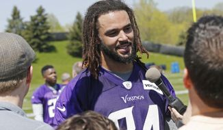 Minnesota Vikings rookie tight end Bucky Hodges, out of Virginia Tech, speaks to reporters during the NFL football team's rookies minicamp Friday, May 5, 2017, in Eden Prairie, Minn. Hodges, the quarterback-turned-tight end made clear he's coming to the NFL with ambition and confidence by picking No. 84, the jersey once worn in Minnesota by Randy Moss. (AP Photo/Jim Mone)