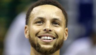 Golden State Warriors guard Stephen Curry smiles during practice Friday, May 5, 2017, in Salt Lake City. The Warriors will play Game 3 of the NBA basketball second-round playoff series against the Utah Jazz on Saturday in Salt Lake City. (AP Photo/Rick Bowmer)