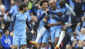Manchester City's Vincent Kompany celebrates scoring his side's second goal of the game during the Premier League soccer match between Manchester City and Crystal Palace at The Etihad Stadium, Manchester, England. Saturday May 6, 2017. (Mike Egerton/PA via AP)