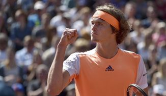 German Alexander Zverev wins the men's singles quarter-final match against the Spaniard Roberto Bautista Agut at the ATP tennis tournament in Munich, Germany, Saturday, May 6 2017.  (Angelika Warmuth/dpa/dpa via AP)