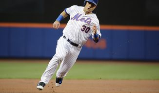 New York Mets' Michael Conforto (30) runs past third base to score on a double by New York Mets' Asdrubal Cabrera during the first inning of a baseball game, Saturday, May 6, 2017, in New York. (AP Photo/Frank Franklin II)