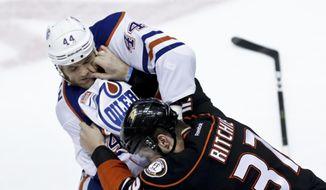 Edmonton Oilers right wing Zack Kassian, left, and Anaheim Ducks left wing Nick Ritchie brawl during the second period in Game 5 of a second-round NHL hockey Stanley Cup playoff series in Anaheim, Calif., Friday, May 5, 2017. (AP Photo/Chris Carlson)