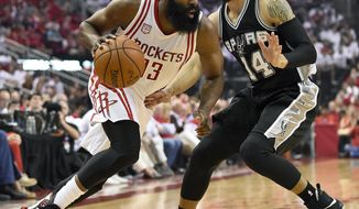 Houston Rockets guard James Harden (13) drives past San Antonio Spurs guard Danny Green (14) during the first half in Game 3 of an NBA basketball second-round playoff series, Friday, May 5, 2017, in Houston. (AP Photo/Eric Christian Smith)