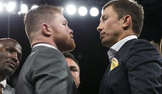 """CORRECTS SOURCE TO LAS VEGAS REVIEW-JOURNAL FROM LAS VEGAS SUN - Saul """"Canelo"""" Alvarez, left, and Gennady Golovkin face each other on Saturday, May 6, 2017, in Las Vegas. The two boxing fighters will fight Sept. 16. (Erik Verduzco/Las Vegas Review-Journal via AP)"""