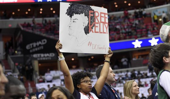A fan holds up a sign in support of Washington Wizards' Kelly Oubre Jr. before Game 4 of a second-round NBA basketball playoff series against the Boston Celtics, Sunday, May 7, 2017, in Washington. Oubre Jr. was suspended for Game 4 due to an incident in Game 3. (AP Photo/Nick Wass)