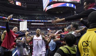 Washington Wizards' Bradley Beal (3) greets fans after Game 4 of a second-round NBA basketball playoff series against the Boston Celtics, Sunday, May 7, 2017, in Washington. (AP Photo/Nick Wass)