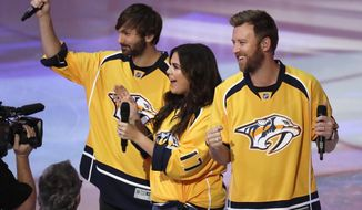 The country group Lady Antebellum performs the national anthem before Game 6 of a second-round NHL hockey playoff series between the Nashville Predators and the St. Louis Blues Sunday, May 7, 2017, in Nashville, Tenn. From left to right, are: Dave Haywood, Hillary Scott and Charles Kelley. (AP Photo/Mark Humphrey)