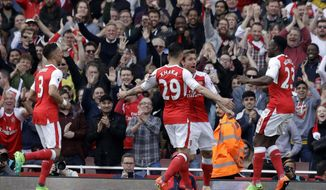 Arsenal players celebrate their goal during the English Premier League soccer match between Arsenal and Manchester United at the Emirates stadium in London, Sunday, May 7, 2017. (AP Photo/Matt Dunham)