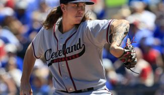 Cleveland Indians starting pitcher Mike Clevinger delivers to a Kansas City Royals batter during the first inning of a baseball game at Kauffman Stadium in Kansas City, Mo., Sunday, May 7, 2017. The Royals are playing in throw-back Kansas City Monarchs uniforms, Indians are playing in Cleveland Buckeyes uniforms as a tribute to the Negro Leagues. (AP Photo/Orlin Wagner)
