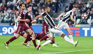 Juventus's Medhi Benatia is chased by Torino players during the Italian Serie A soccer match between Juventus and Torino at the Juventus Stadium in Turin, Italy, Saturday, May 6, 2017. (Alessandro Di Marco/ANSA via AP)
