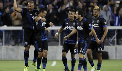San Jose Earthquakes forward Chris Wondolowski, second from left, celebrates his goal with teammates during the first half of an MLS soccer match against the Portland Timbers, Saturday, May 6, 2017, in San Jose, Calif. (AP Photo/Marcio Jose Sanchez)