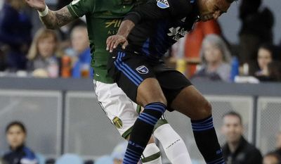 Portland Timbers defender Liam Ridgewell, left, works for a head ball next to San Jose Earthquakes' Danny Hoesen during the first half of an MLS soccer match, Saturday, May 6, 2017, in San Jose, Calif. (AP Photo/Marcio Jose Sanchez)
