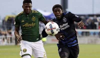 Portland Timbers forward Dairon Asprilla, left, eyes the ball as San Jose Earthquakes defender Kofi Sarkodie, right, chases during the first half of an MLS soccer match, Saturday, May 6, 2017, in San Jose, Calif. (AP Photo/Marcio Jose Sanchez)