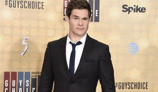"""FILE - In this June 4, 2016 file photo, Adam Devine arrives at the Guys Choice Awards at Sony Pictures Studios in Culver City, Calif. MTV is heralding the start of summer viewing season with its Movie & TV Awards on Sunday, May 7, 2017. Hosted by actor Devine, the MTV Movie & TV Awards will also feature sneak peeks of anticipated films including """"Transformers: The Last Knight"""" and """"Spider-Man: Homecoming."""" (Photo by Dan Steinberg/Invision/AP, File)"""