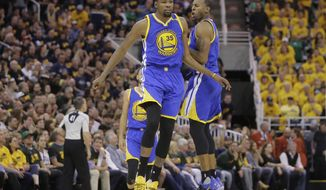 Golden State Warriors' Andre Iguodala, right, celebrates with Kevin Durant (35) after he scores against the Utah Jazz in the second half during Game 3 of the NBA basketball second-round playoff series Saturday, May 6, 2017, in Salt Lake City.  (AP Photo/Rick Bowmer)
