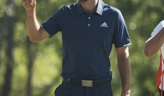 Dustin Johnson tips his hat to the fans on the 18th hole during the final round of the Wells Fargo Championship golf tournament at Eagle Point Golf Club in Wilmington, N.C., Sunday, May 7, 2017. (AP Photo/Mike Spencer)