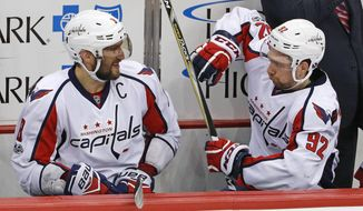 Washington Capitals' Alex Ovechkin (8) and Evgeny Kuznetsov (92) celebrate on the bench in the final seconds of a 5-2 win over the Pittsburgh Penguins in Game 6 of an NHL Stanley Cup Eastern Conference semifinal hockey game in Pittsburgh, Monday, May 8, 2017. (AP Photo/Gene J. Puskar)