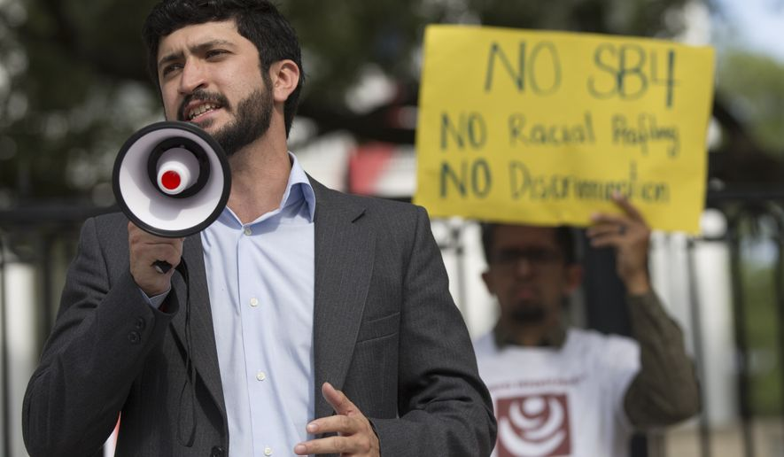 "Gregorio Casar speaks during a protest outside of the Texas Governor's Mansion in Austin, Texas, Monday, May 8, 2017. The gathering was to protest Texas' new ""sanctuary cities"" law, which takes effect in September and which critics say is the most anti-immigrant since a 2010 Arizona law, that will allow police officers to ask about the immigration status of anyone they detain, including during routine traffic stops. Republican Gov. Greg Abbott signed the law Sunday evening on Facebook Live with no advanced warning. (Ricardo B. Brazziell/Austin American-Statesman via AP)"