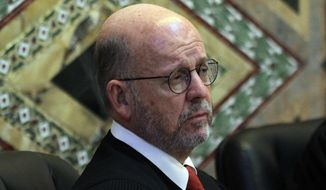 Senior Circuit Judge Michael Daly Hawkins is one of three judges appointed by President Clinton who is hearing the Trump administration's appeal of Hawaii's so-far successful challenge to the president's travel ban that targets six predominantly Muslim countries. (Associated Press/File)