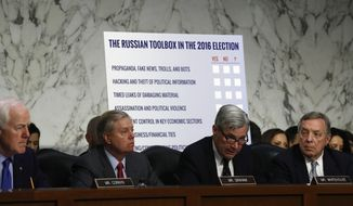 """Sen. Sheldon Whitehouse, D-R.I., ranking member on the Senate Judiciary subcommittee on Crime and Terrorism, second from right, accompanied by, from left, Senate Majority Whip John Cornyn of Texas, subcommittee Chairman Sen. Lindsey Graham, R-S.C., and Senate Minority Whip Richard Durbin of Ill., speaks on Capitol Hill in Washington, Monday, May 8, 2017, during the subcommittee's hearing: """"Russian Interference in the 2016 United States Election."""" (AP Photo/Carolyn Kaster)"""