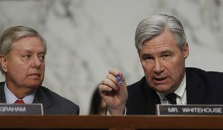 """Senate Judiciary subcommittee on Crime and Terrorism Chairman Sen. Lindsey Graham, R-S.C., listens at left as the committee's ranking member Sen. Sheldon Whitehouse, D-R.I., speaks on Capitol Hill in Washington, Monday, May 8, 2017, during the subcommittee's hearing: """"Russian Interference in the 2016 United States Election."""" (AP Photo/Carolyn Kaster)"""