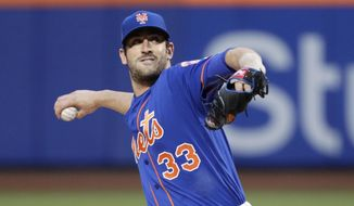 FILE - In a Friday, April 21, 2017 file photo, New York Mets' Matt Harvey (33) delivers a pitch during the first inning of a baseball game against the Washington Nationals, in New York. The New York Mets have scratched Harvey for his scheduled start Sunday, May 7, 2017, against the Miami Marlins and suspended the right-hander three days for a violation of team rules.  (AP Photo/Frank Franklin II, File)