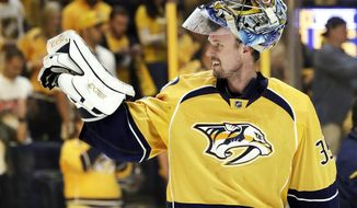 Nashville Predators goalie Pekka Rinne, of Finland, waves to fans as he leaves the ice after his team defeated the St. Louis Blues in Game 6 of a second-round NHL hockey playoff series Sunday, May 7, 2017, in Nashville, Tenn. (AP Photo/Mark Humphrey)