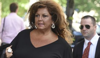 """Former """"Dance Moms"""" reality star Abby Lee Miller arrives at the Joseph F. Weis Jr. U. S. Courthouse in Pittsburgh for her sentencing on federal bankruptcy fraud charges,Monday, May 8, 2017. (Darrell Sapp/Pittsburgh Post-Gazette via AP)"""