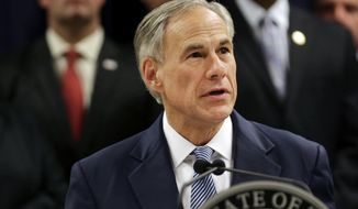 "FILE - In this April 10, 2017, file photo, Texas Gov. Greg Abbott speaks at a new conference in Houston. Abbott on Sunday, May 7, 2017, signed a so-called ""sanctuary cities"" ban that lets police ask during routine stops whether someone is in the U.S. legally and threatens sheriffs with jail if they don't cooperate with federal immigration agents. (Marie D. De Jesus /Houston Chronicle via AP, File)"