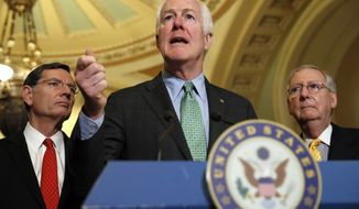 Senate Majority Whip John Cornyn of Texas, center, flanked by Sen. John Barrasso, R-Wyo., left, and Senate Majority Leader Mitch McConnell of Ky., speak to the media about healthcare, Tuesday, May 9, 2017, on Capitol Hill in Washington following a policy luncheon. (AP Photo/Jacquelyn Martin)