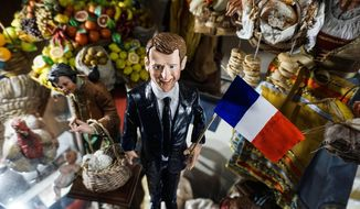 The statuette portraying  newly elected French President Emmanuel Macron is on display in a shop at San Gregorio Armeno street in Naples, southern Italy, Tuesday, May 92017. Via San Gregorio Armeno is a street famous for its shops selling hand-crafted nativity scenes and all kind of painted figurines and statuettes. (Cesare Abbate/ANSA via AP)