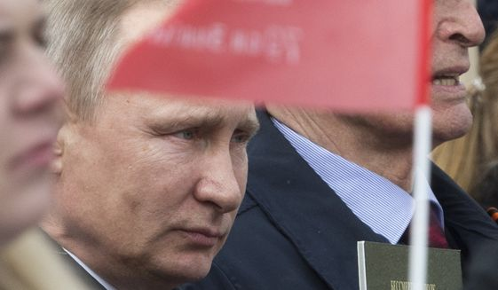 Russian President Vladimir Putin participated in the Immortal Regiment march at the Red Square in Moscow on Tuesday to mark 72 years since the end of World War II and the Soviet defeat of Nazi Germany. (Associated Press)