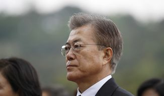 New South Korea's President Moon Jae-in arrives at the National Cemetery in Seoul, South Korea Wednesday, May 10, 2017. Moon visited the national cemetery where he honored the country's former presidents, independence fighters and war heroes as he began his presidential duties. (Kim Hong-ji/Pool Photo via AP)